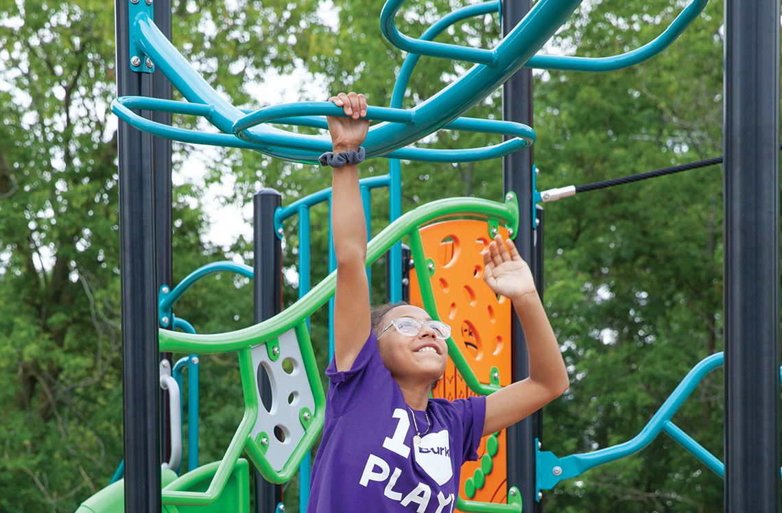 child on playground equipment